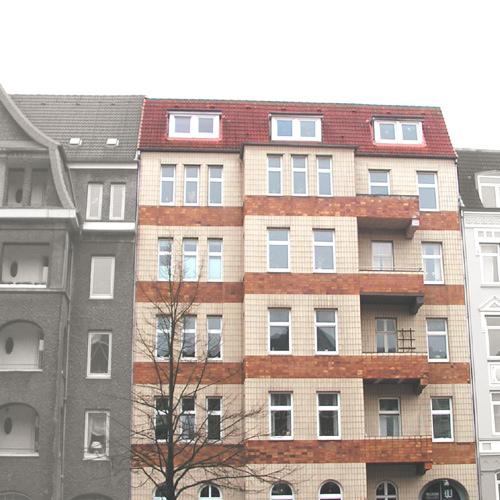 Fassadensanierung und Planung einer Dachterrasse